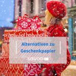 Frau mit Weihnachtsgeschenken in der Hand als Beitragsbild für günstige Alternativen für Geschenkpapier