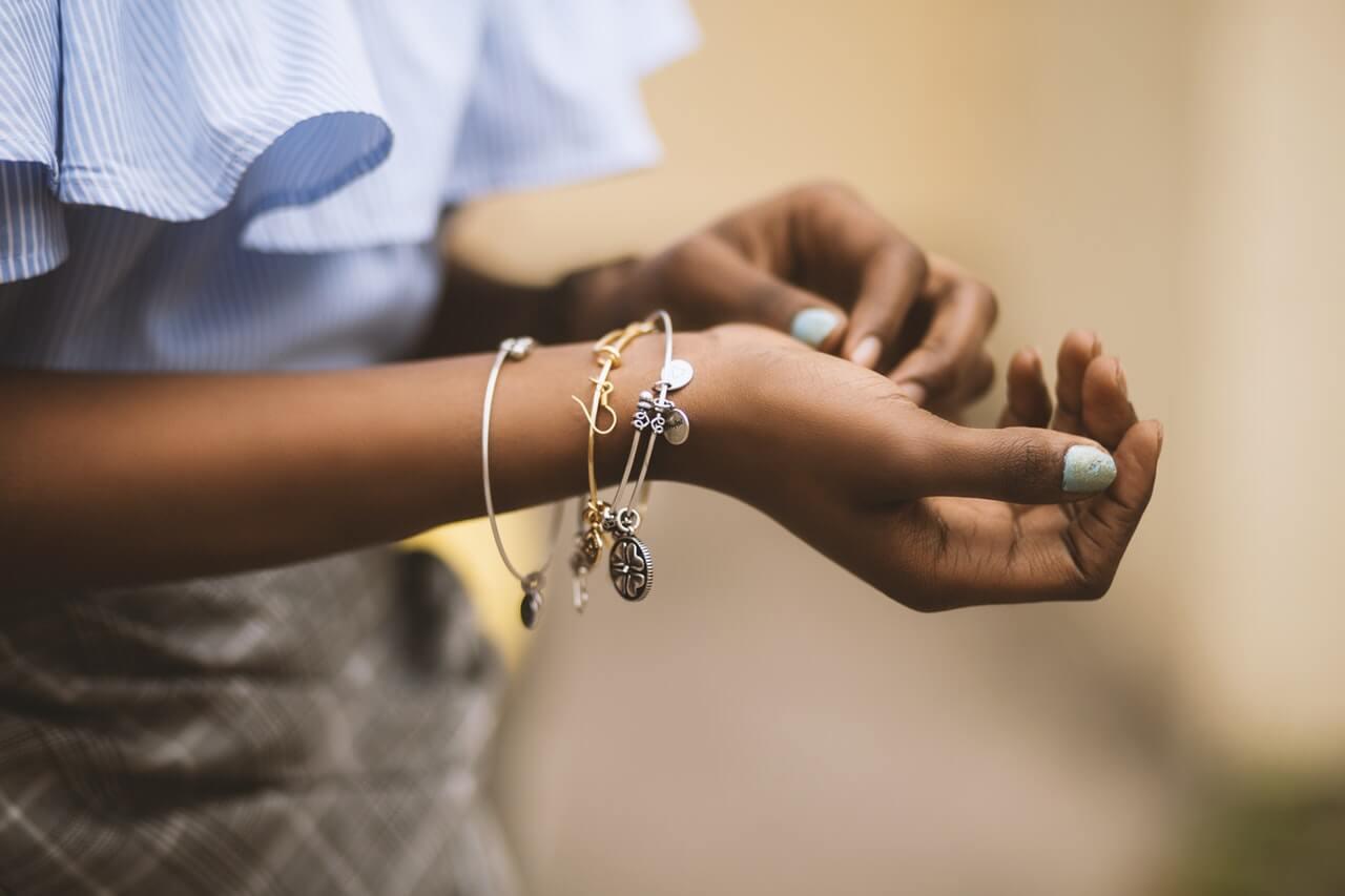 Girl wearing shiny bracelets