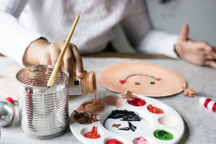 Child playing with paints