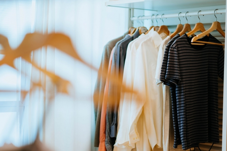 clothes rack with hanging shirts