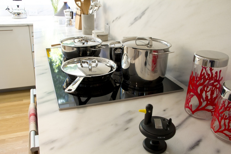 tidy kitchen with cleans pots and pans