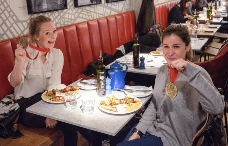 Marathon winners eating at the restaurant