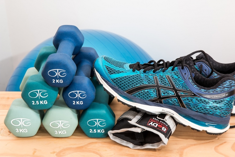 gym shoes and dumbells