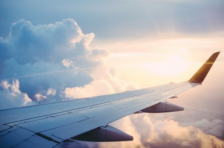 plane window in sky