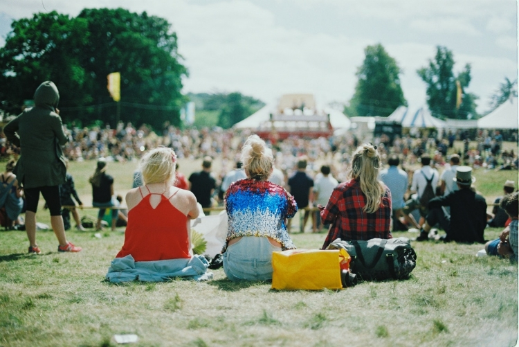 girls sat at music festival
