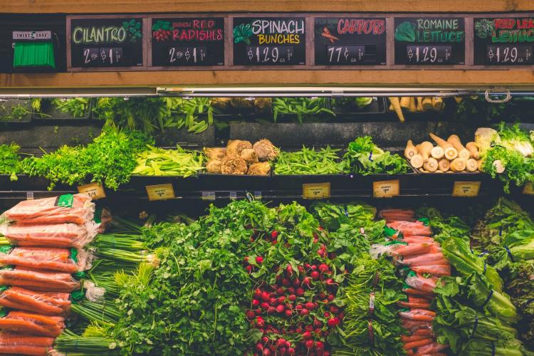 fresh vegetables piled up at market