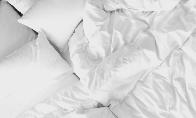 white bedding and pillows